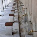 Blue Mosque; array of foot washing stations - Istanbul, Turkey